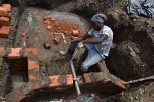 The Water Project: Mwera Community, Mukunga Spring -  Pipe Setting