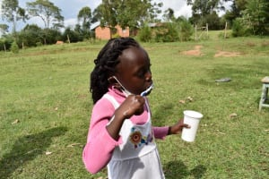 The Water Project: Mwera Community, Mukunga Spring -  Blessing Cleaning Her Mouth