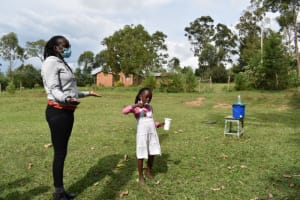 The Water Project: Mwera Community, Mukunga Spring -  Blessing Shows How To Clean Teeth