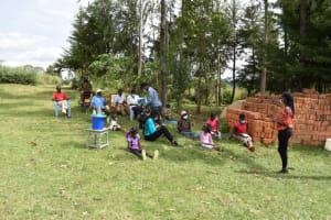 The Water Project: Mwera Community, Mukunga Spring -  Distributing Writing Material