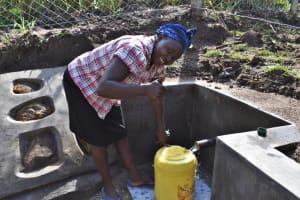 The Water Project: Mwera Community, Mukunga Spring -  Fetching Water At The Water Point
