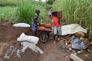 The Water Project: Mwera Community, Mukunga Spring -  Relocating The Bricks