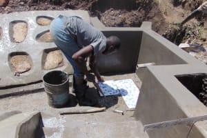 The Water Project: Mwera Community, Mukunga Spring -  Tiles Fixing