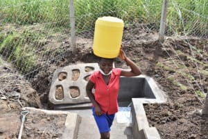 The Water Project: Mwera Community, Mukunga Spring -  Carrying Water From Spring