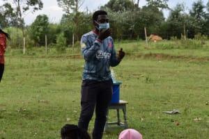 The Water Project: Mwera Community, Mukunga Spring -  Explaining Importance Of Masks