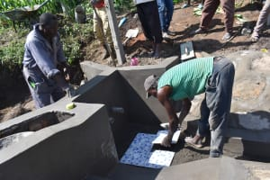 The Water Project: Sundulo B Community, Luvisia Spring -  Tiles Fitting