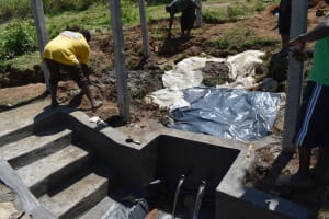 The Water Project: Sundulo B Community, Luvisia Spring -  Backfilling With Plastic
