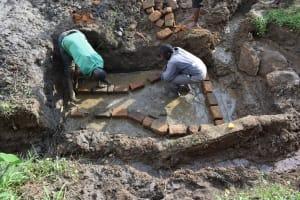The Water Project: Sundulo B Community, Luvisia Spring -  Brick Setting