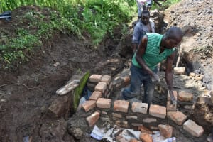 The Water Project: Sundulo B Community, Luvisia Spring -  Wall Construction