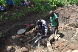The Water Project: Sundulo B Community, Luvisia Spring -  Pipe Setting