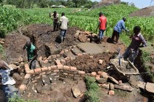 The Water Project: Sundulo B Community, Luvisia Spring -  Raising The Wall
