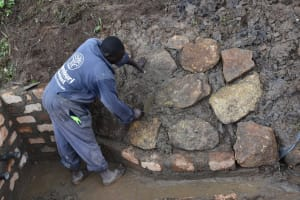 The Water Project: Sundulo B Community, Luvisia Spring -  Stone Pitching