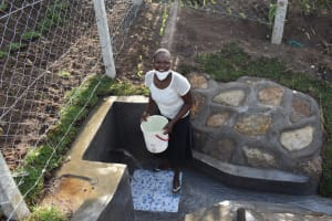 The Water Project: Sundulo B Community, Luvisia Spring -  Carrying Water Home