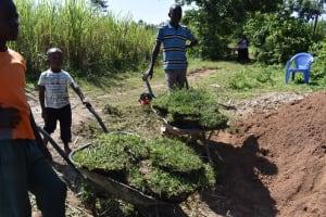 The Water Project: Sundulo B Community, Luvisia Spring -  Community Members Gather Grass