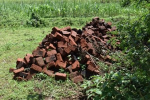 The Water Project: Sundulo B Community, Luvisia Spring -  Construction Bricks