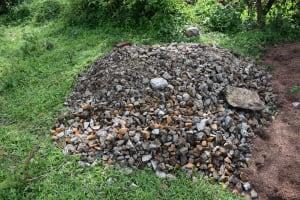 The Water Project: Sundulo B Community, Luvisia Spring -  Construction Gravel