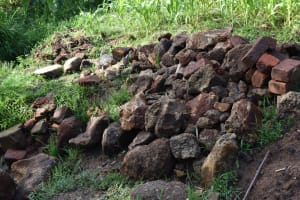 The Water Project: Sundulo B Community, Luvisia Spring -  Construction Large Stones