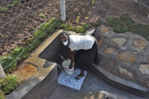 The Water Project: Sundulo B Community, Luvisia Spring -  Fetching Water