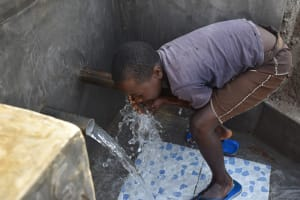 The Water Project: Sundulo B Community, Luvisia Spring -  Getting A Drink
