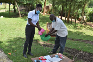 The Water Project: Sundulo B Community, Luvisia Spring -  Hand Washing Demonstration