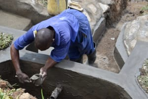 The Water Project: Shianda Community, Govet Lumbasi Spring -  Outside Plaster