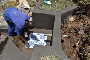 The Water Project: Shianda Community, Govet Lumbasi Spring -  Setting The Tiles