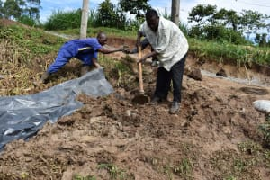 The Water Project: Shianda Community, Govet Lumbasi Spring -  Backfilling With Soil Cover