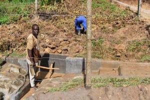 The Water Project: Shianda Community, Govet Lumbasi Spring -  Backingfilling With Stones