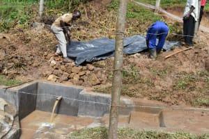 The Water Project: Shianda Community, Govet Lumbasi Spring -  Plastic Sheeting