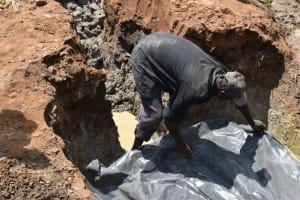 The Water Project: Shianda Community, Govet Lumbasi Spring -  Foundation Plastic Sheet