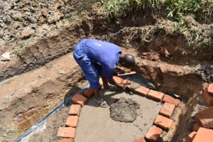 The Water Project: Shianda Community, Govet Lumbasi Spring -  Brick Setting