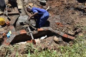 The Water Project: Shianda Community, Govet Lumbasi Spring -  Pipe Setting Measurement