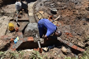 The Water Project: Shianda Community, Govet Lumbasi Spring -  Discharge Pipe Setting