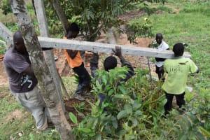 The Water Project: Shianda Community, Govet Lumbasi Spring -  Erecting Fencing Poles