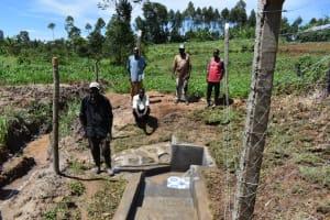 The Water Project: Shianda Community, Govet Lumbasi Spring -  Men At Water Point
