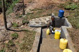 The Water Project: Shianda Community, Govet Lumbasi Spring -  Taking Water Home