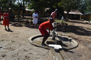 The Water Project: Mukambi Baptist Primary School -  Collecting Water At The Well