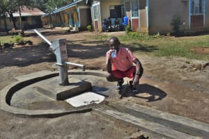 The Water Project: Mukambi Baptist Primary School -  Drinking Water From The Well