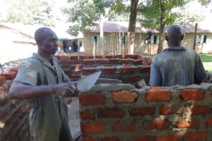 The Water Project: Mukambi Baptist Primary School -  Laying Bricks For Latrines