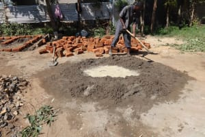 The Water Project: Mukambi Baptist Primary School -  Mixing Water With Cement