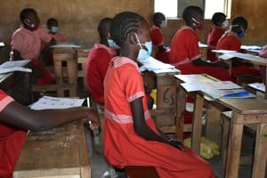 The Water Project: Mukambi Baptist Primary School -  Students Listening During The Pandemic
