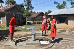 The Water Project: Mukambi Baptist Primary School -  Students Pump The Well