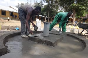 The Water Project: Mukambi Baptist Primary School -  Team Finalizing Well Pad