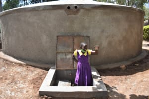 The Water Project: Kapsogoro Primary School -  Child Enjoying The Water