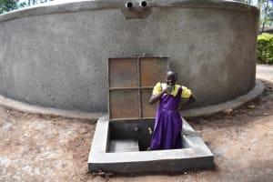 The Water Project: Kapsogoro Primary School -  Children Drinking Water
