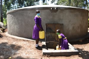 The Water Project: Kapsogoro Primary School -  Children Fetching Water