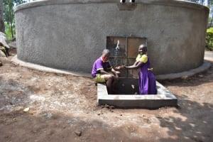 The Water Project: Kapsogoro Primary School -  Children Splashing Water