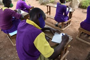 The Water Project: Kapsogoro Primary School -  Participants Taking Notes