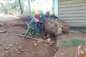 The Water Project: Kapsogoro Primary School -  Removing A Rock From The Site