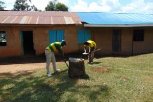 The Water Project: Jivuye Primary School -  Taking Measurements For Excavation